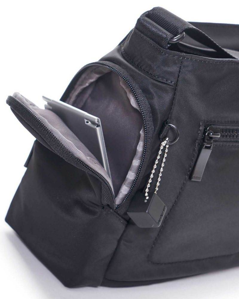 ad21fb34bfd1 ... 2 side zippered pockets for quick access · Hedgren COMMUTER Horizontal  Crossover Bag with RFID ...